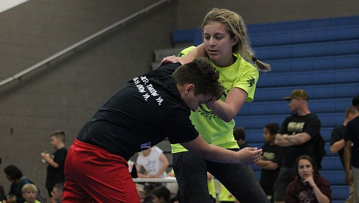 Cora Custer squares off with an opponent during the Falcons Wrestling Tournament in April 2019 at Kingman High School. (Miner file photo)