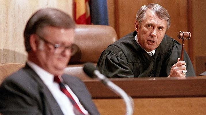 In this March 29, 1988, file photo, Arizona Supreme Court Chief Justice Frank X. Gordon Jr., right, waves his gavel at the defense's expert witness, attorney Robert L'Ecuyer, as Gordon threatened him with contempt of court during the impeachment trial of Arizona Gov. Evan Mecham in Phoenix. (Jeff Robbins/AP)
