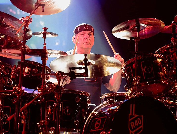 This June 25, 2015 file photo shows Neil Peart of the band Rush performing in concert during their R40 Live: 40th Anniversary Tour in Philadelphia. (Owen Sweeney/Invision/AP)
