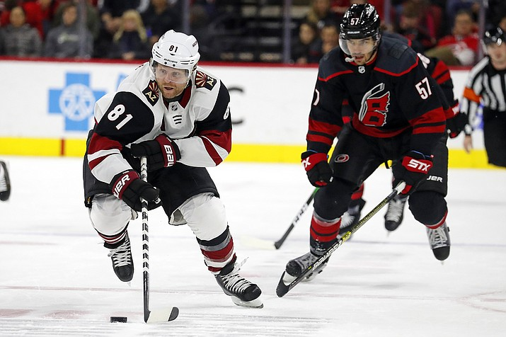 Arizona Coyotes' Phil Kessel (81) brings the puck up the ice after taking it away from Carolina Hurricanes' Trevor van Riemsdyk (57) during the second period of a game in Raleigh, N.C., Friday, Jan. 10, 2020. (Karl B DeBlaker/AP)