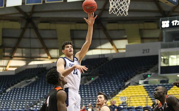 NAU forward Brooks DeBisschop  (22) goes up for a hook shot during a game against Idaho State on Saturday, Jan. 11, 2020, at the Walkup Dome in Flagstaff. (Maria Saldivar, NAU Athletics/Courtesy)