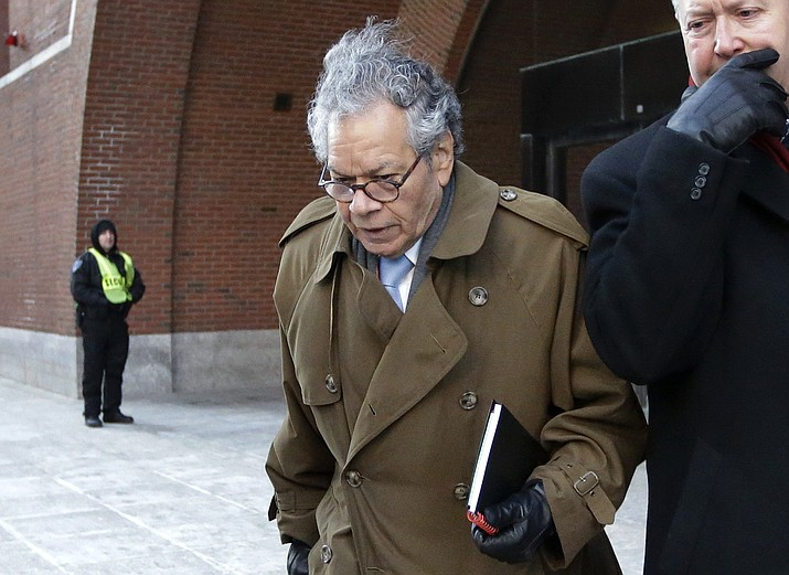 In this Jan. 30, 2019, file photo, Insys Therapeutics founder John Kapoor leaves federal court in Boston. Kapoor and former top employees of the pharmaceutical company are facing a reckoning for their role in a bribery scheme that prosecutors say boosted sales of a powerful, highly addictive painkiller and helped fuel the national opioid epidemic.Starting Monday, Jan. 13, 2020, seven people who worked for Insys Therapeutics will appear in Boston to be sentenced by a federal judge. (AP Photo/Steven Senne, File)