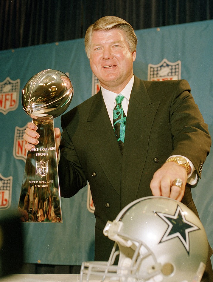 In this Jan. 28, 1994, file photo, Dallas Cowboys head coach Jimmy Johnson poses with the Vince Lombardi Super Bowl trophy during an NFL football news conference in Atlanta. Johnson, who coached the Cowboys to two Super Bowl championships in the 1990s, has been elected to the Pro Football Hall of Fame. The hall announced his selection Sunday night as part of a centennial class that was chosen on Wednesday by a special committee. Former Pittsburgh Steelers coach Bill Cowher was revealed Saturday night as the other coach being inducted. (AP Photo/Ron Heflin, File)