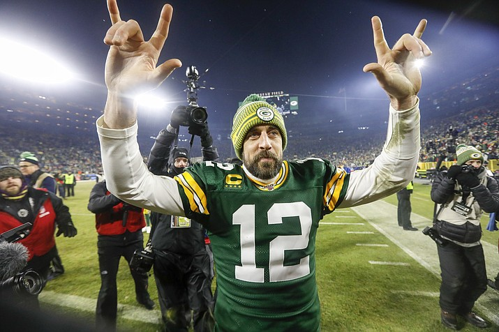 Green Bay Packers' Aaron Rodgers celebrates as he walks off the field after an NFL divisional playoff football game against the Seattle Seahawks Sunday, Jan. 12, 2020, in Green Bay, Wis. The Packers won 28-23 to advance to the NFC Championship. (Mike Roemer/AP)