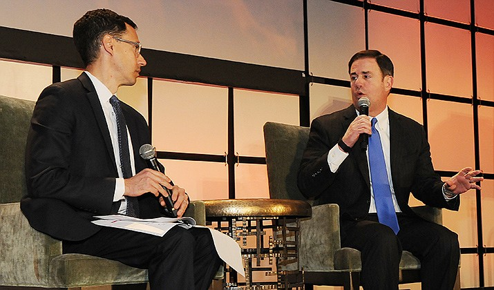 "Gov. Doug Ducey chats Friday with Glenn Hamer, president of the Arizona Chamber of Commerce and Industry. The governor's annual ""State of the State"" speech is due to be delivered Monday. (Capitol Media Services photo by Howard Fischer)"