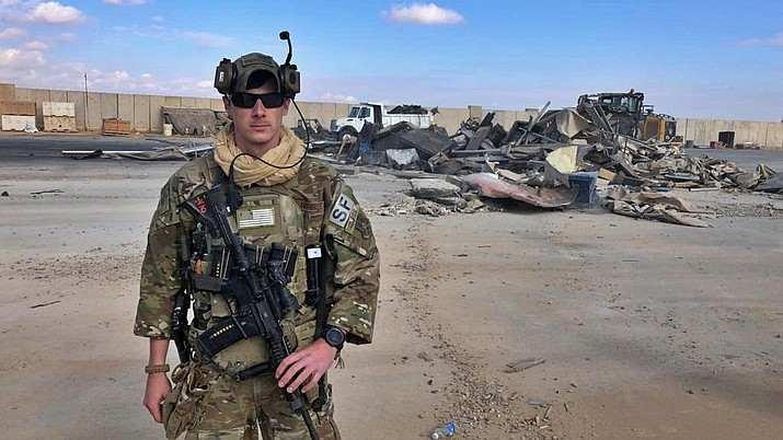 A U.S. soldier stands while bulldozers clear rubble and debris at Ain al-Asad air base in Anbar, Iraq, Monday, Jan. 13, 2020. Ain al-Asad air base was struck by a barrage of Iranian missiles on Wednesday, in retaliation for the U.S. drone strike that killed atop Iranian commander, Gen. Qassem Soleimani, whose killing raised fears of a wider war in the Middle East. (AP Photo/Ali Abdul Hassan)