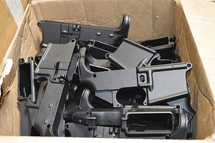 Pictured are AR-15 lower receivers, which federal agents have seized, including these unfinished ones taken in 2014 in California, for firearms investigations nationwide. For decades, the federal government has treated the mechanism called the lower receiver as the essential piece of the semiautomatic rifle, which has been used in some of the nation's deadliest mass shootings. But some defense attorneys have recently argued that the part alone does not meet the definition in the law. (U.S. Department of Justice)