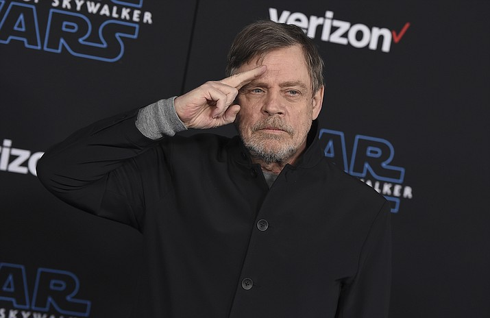 "In this Dec. 16, 2019, file photo, Mark Hamill arrives at the world premiere of ""Star Wars: The Rise of Skywalker"" in Los Angeles. The force was strong enough at an Arizona store to reunite Luke Skywalker with his long-lost vinyl record. Hamill is praising workers at Bookmans Entertainment Exchange in Flagstaff for returning the ""Star Wars: A New Hope"" soundtrack that had been a gift from film composer John Williams. Hamill said in a tweet Saturday, Jan. 11, 2020, that it felt ""totally unexpected & positively surreal"" to get back the record he had not seen since the early 1990s. He commended the store about 145 miles (233 kilometers) north of Phoenix for being honest and not selling it. (Jordan Strauss/Invision/AP, File)"