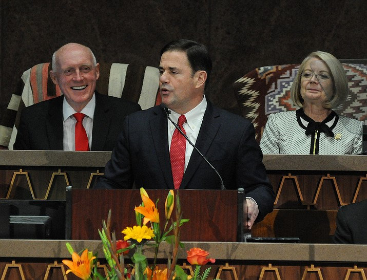Gov. Doug Ducey  (center) speaks during his State of the State address as Senate president Karen Fann, R-Prescott (right), and House Speaker Rusty Bowers, R-Mesa (left), listen in at the Capitol, Monday, Jan. 13, 2020, in Phoenix. (Howard Fischer/Capitol Media Services)
