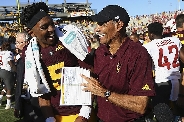 Arizona State quarterback Jayden Daniels (5) celebrates with head coach Herm Edwards, right, after an NCAA college football game win over Washington State, Saturday, Oct. 12, 2019, in Tempe. (Ross D. Franklin/AP, file)
