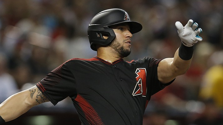 In this Aug. 17, 2019 file photo Arizona Diamondbacks' David Peralta hits against the San Francisco Giants in the first inning of a baseball game in Phoenix. The Diamondbacks have finalized a $22 million, three-year contract with Peralta that runs through 2022, Monday, Jan. 13, 2020. (Rick Scuteri/AP, file)