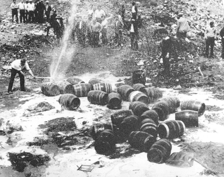 In this June 18, 1931 photo, beer barrels are destroyed by prohibition agents at a dump in New York City. The federal government, as well as state and local authorities, spent huge sums on enforcement yet never allocated sufficient resources to do the job effectively. Bootleggers awash in cash bribed judges, politicians and law enforcement officers to let their operations continue. (AP Photo, File)