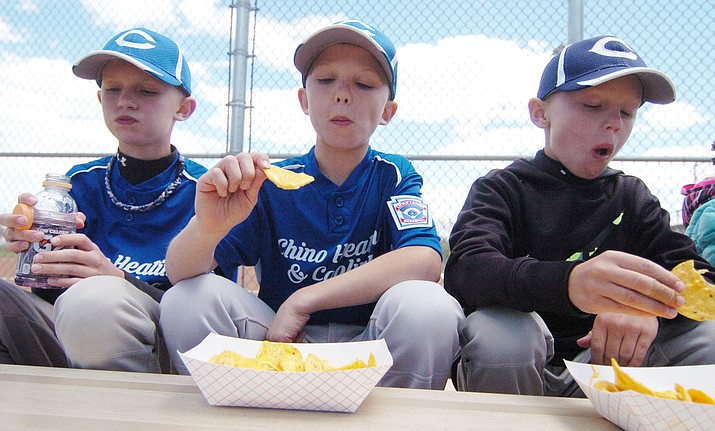 In this undated file photo, Trenton Legler, Ivan Schuster and Tucker Legler enjoy some nachos before opening ceremonies for the Chino Valley Little League. Registration for Chino Valley Little League's 2020 season is available online at tshq.bluesombrero.com/chinovalleyllaz through Sunday, Feb. 23. (Les Stukenberg/Review, file)