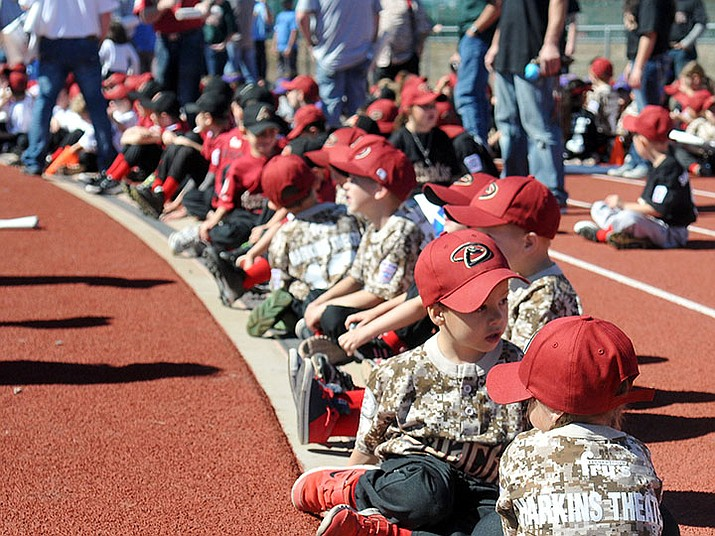 Prescott Valley Little Leaguers line the track at Bob Pavlich Field at Bradshaw Mountain High School during the 2016 opening ceremony. (Tribune file photo)