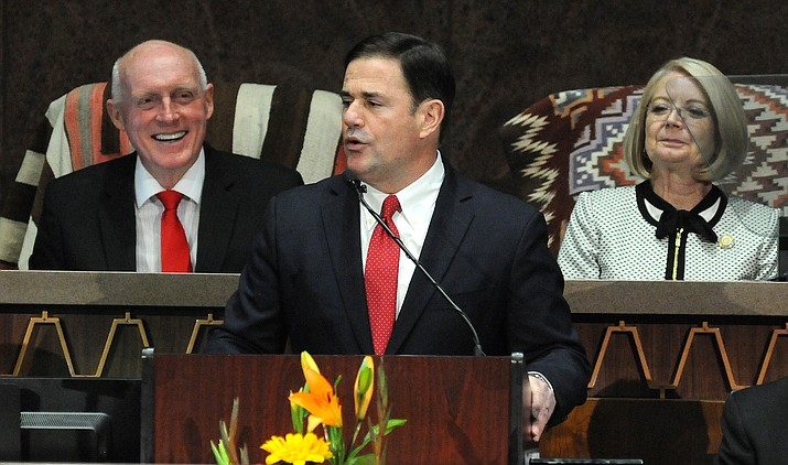 Gov. Doug Ducey addresses the Legislature on Monday, with House Speaker Rusty Bowers and Senate President Karen Fann in the background. (Capitol Media Services photo by Howard Fischer)