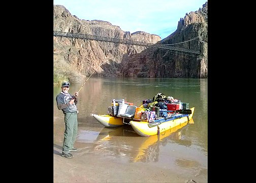 Jon Sanders of Williams, Arizona reels in a boat he caught during a recent fishing trip in the Grand Canyon. (Submitted photo)