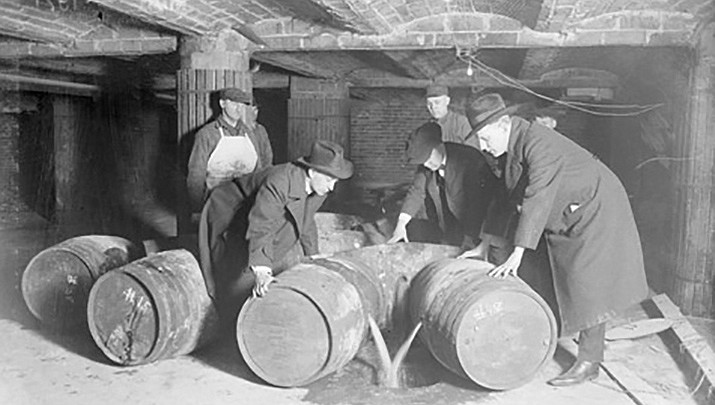 Prohibition agents destroy barrels of alcohol in this 1921 photo from the Chicago Daily News negatives collection at the Chicago Historical Society. Prohibition began 100 years ago this week. (Public domain)