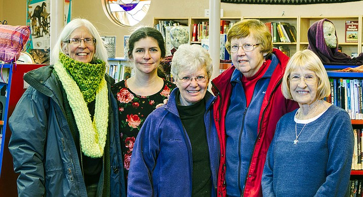 "VV Weavers & Spinners, with Art in the Clark curator Jenny Emminger, take a break from installing their ""Woven Wonders"" at Clark Memorial Library.  From left to right: Lorraine Lewis, Jenny, Cass Schorsch, Jill Suydam, and Linda Dettman."