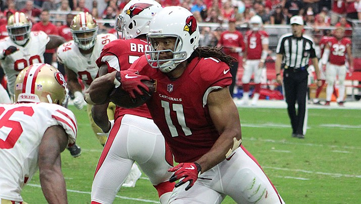 Wide receiver Larry Fitzgerald has signed a one-year contract to return to the St. Louis Cardinals for a 14th season. (Miner file photo)
