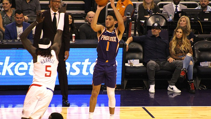 Phoenix's Devin Booker scored 39 points before he was ejected for his second technical foul following his dunk with less than two minutes remaining during a 123-110 loss to the Hawks on Tuesday night. (Miner file photo)