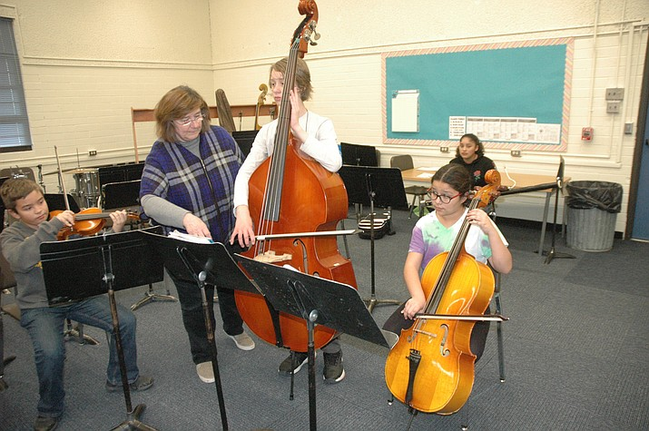 Luann Mueller, director of the Prescott Jr. Youth Symphony, giving instruction to Granite Mountain School students who have become a part of the new group, on Thursday, Jan. 9, 2020. (Jason Wheeler/Courier)
