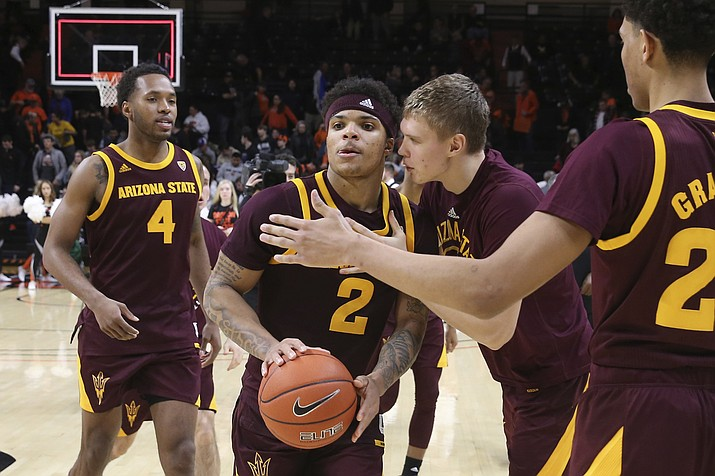 Arizona State's Rob Edwards (2) is congratulated by teammates after Arizona State defeated Oregon State 82-76 in an NCAA college basketball game in Corvallis, Ore., Thursday, Jan. 9, 2020. (Chris Pietsch/AP)