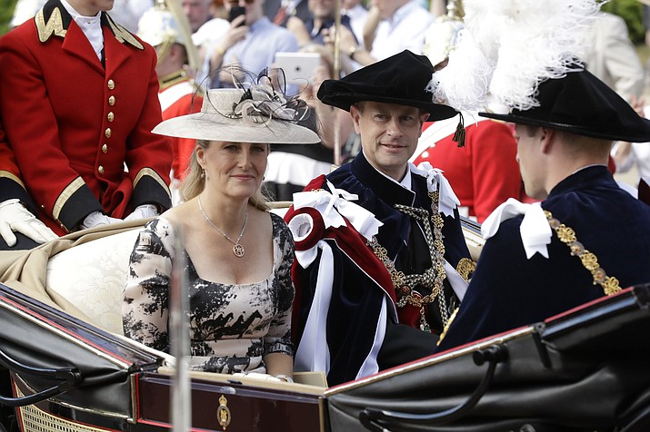 In this Monday, June 18, 2018 file photo, Britain's Prince Edward, center, in his roles as Knight Companion and his wife Sophie, Countess of Wessex, leave in a carriage after the Order of The Garter Service at Windsor Castle in Windsor, England. As the British royal family wrestles with the future roles of Prince Harry and his wife Meghan, it could look to Europe for examples of how princes and princesses have tried to carve out careers away from the pomp and ceremony of their families' traditional duties. Prince Edward, the youngest son of Queen Elizabeth II, in 1993 launched a TV production firm that failed in 2011, and his wife Sophie tried to keep her established public relations firm going after she married Edward in 1999. (Matt Dunham/AP, pool, file)