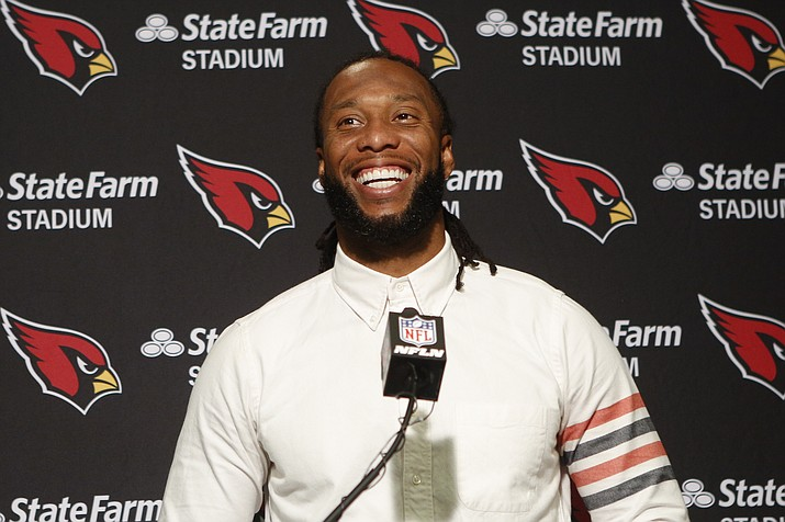 In this Oct. 6, 2019, photo, Arizona Cardinals wide receiver Larry Fitzgerald attends a news conference after winning a game against the Cincinnati Bengals, in Cincinnati. (Frank Victores/AP, file)