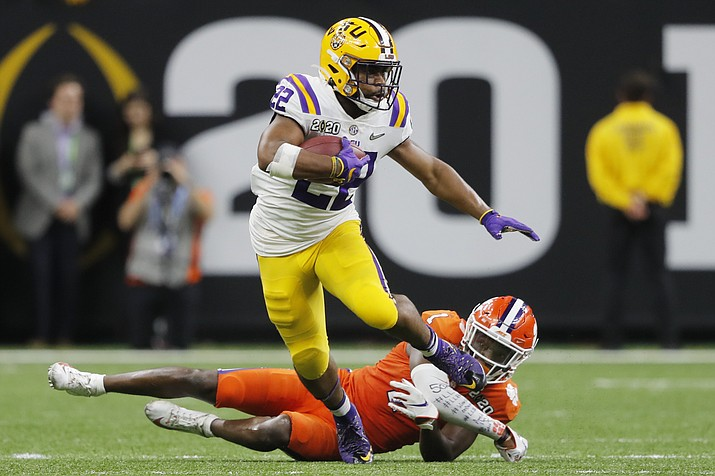 LSU running back Clyde Edwards-Helaire breaks away from Clemson cornerback Derion Kendrick during the second half of a NCAA College Playoff national championship game Monday, Jan. 13, 2020, in New Orleans. (Gerald Herbert/AP)