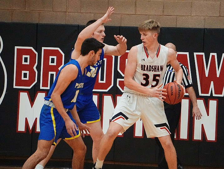 Prescott center Korey Schwartz (32) and guard Dellinger Boyd (10) defend Bradshaw Mountain center Nathan Summit (35) in the post during a game on Tuesday, Jan. 14, 2020, in Prescott Valley. (Aaron Valdez/Courier)