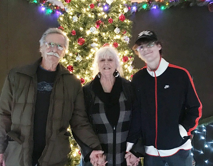 Randy and Melodie Passmore with their orphaned grandson Collin Clabaugh. The homeowner's association board at the senior living community their home is in is saying Clabaugh can't live them because he doesn't meet the community's age requirement. (Melodie Passmore/Courtesy)