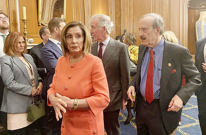House Speaker Nancy Pelosi and Democratic impeachmnet managers head to deliver the articles of impeachment against President Donald Trump to the Senate. (Photo by McKenzie Sadeghi/Cronkite News)