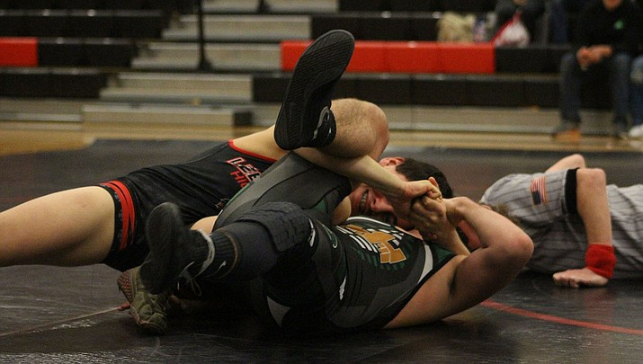 Lee Williams' Christian Marzo pins his Mohave opponent Wednesday with 48 seconds remaining in the first period. The Vols won the dual meet 38-21. (Photo by Beau Bearden/Kingman Miner)