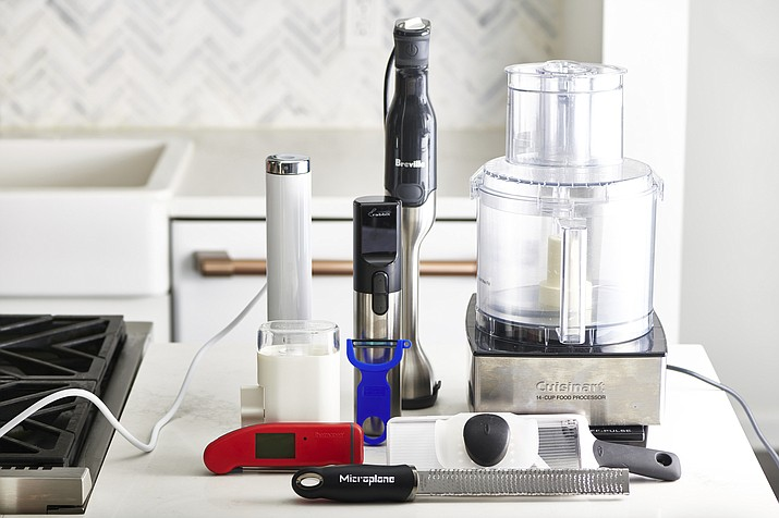 This December 2019 photo shows an assortment of various kitchen gadgets in New York, including a food processor, back right. (Cheyenne Cohen/Katie Workman via AP)