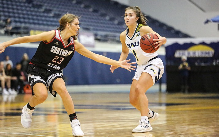 NAU guard Regan Schenck (1) tries to shed her defender during a game against Southern Utah on Thursday, Jan. 16, 2020, at the Walkup Skydome in Flagstaff. (Maria Saldivar, NAU Athletics/Courtesy)