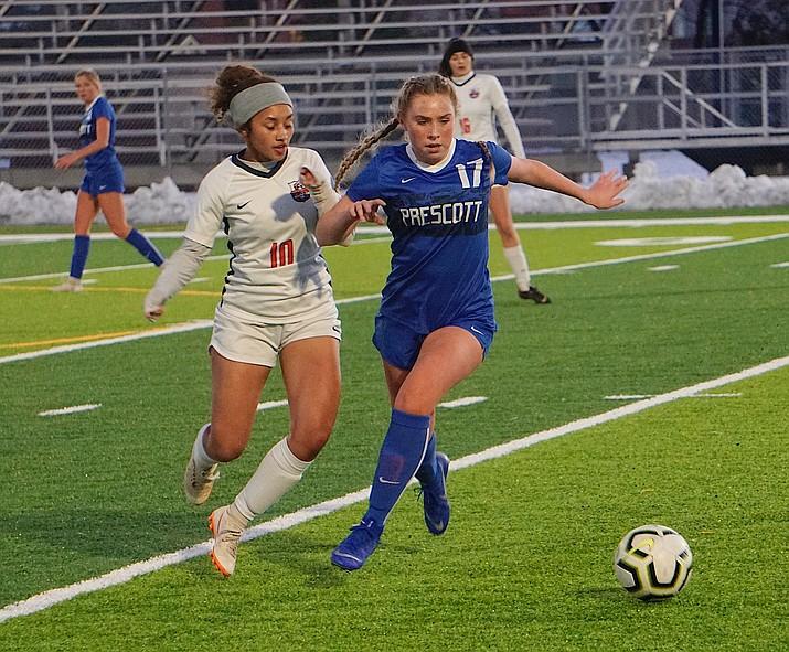 Prescott midfielder Ellie Magnett (17) holds off a defender during a game against Poston Butte on Friday, Jan. 10, 2020, at Bill Shepard Field in Prescott. (Aaron Valdez/Courier, file)