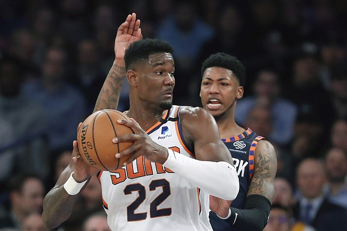 New York Knicks guard Elfrid Payton, right, defends as Phoenix Suns center Deandre Ayton (22) looks to pass during the first quarter of a game in New York, Thursday, Jan. 16, 2020. (Kathy Willens/AP)