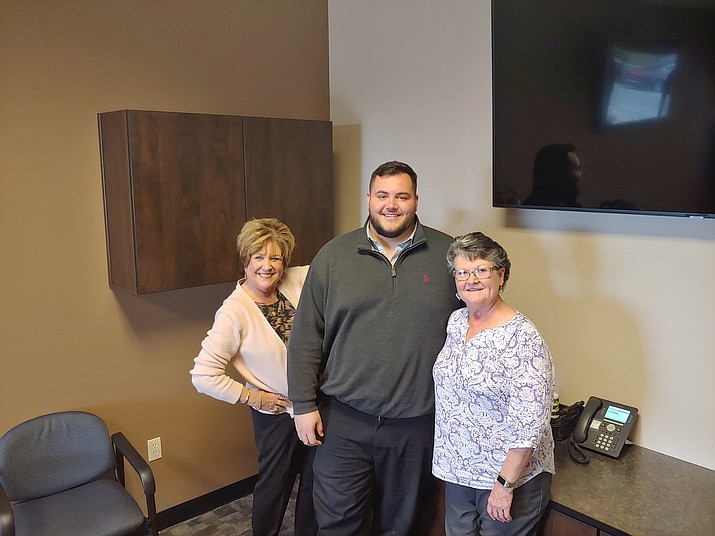 Prescott Valley Chamber of Commerce staffers, from left, President/CEO Marnie Uhl, Membership Services Manager Brady Cabral and Operations and Events Manager Gloria Grose are thrilled with the recent expansion of the chamber building at 7120 Pav Way Suite 102. (Doug Cook/Courier)