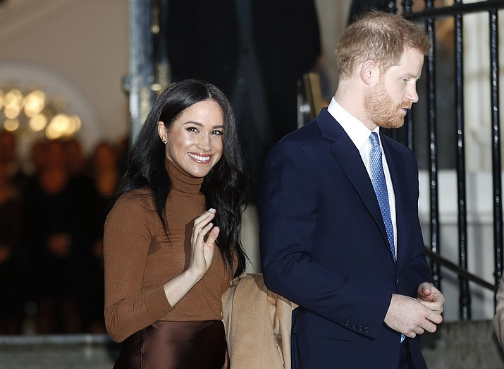 In this Jan. 7, 2020 photo, Britain's Prince Harry and Meghan, Duchess of Sussex leave after visiting Canada House in London, after their recent stay in Canada. Prince Harry and Meghan Markle are to no longer use their HRH titles and will repay £2.4 million of taxpayer's money spent on renovating their Berkshire home, Buckingham Palace announced Saturday, Jan. 18. 2020. (Frank Augstein/AP, File)