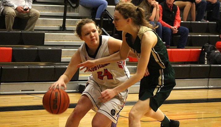 Lee Williams senior Liberty Cronk, left, notched a game-high 15 points Friday in a 40-27 win at Mingus. (Miner file photo)