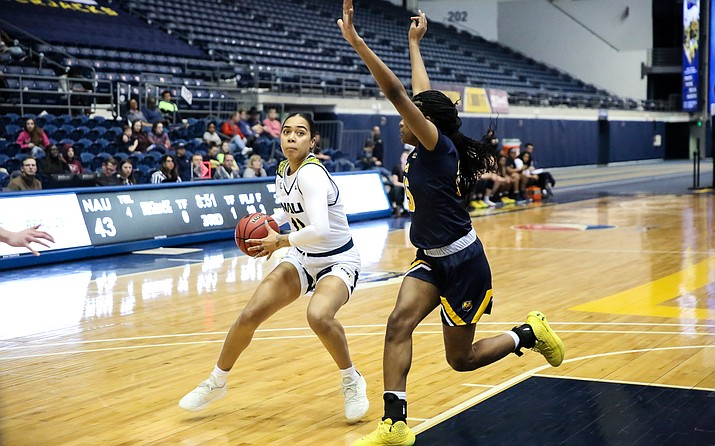 NAU forward Jacey Bailey (11) attempts to dribble past a defender during a game against Northern Colorado on Saturday, Jan. 18, 2020, at the Walkup Skydome in Flagstaff. (Maria Saldivar, NAU Athletics/Courtesy)