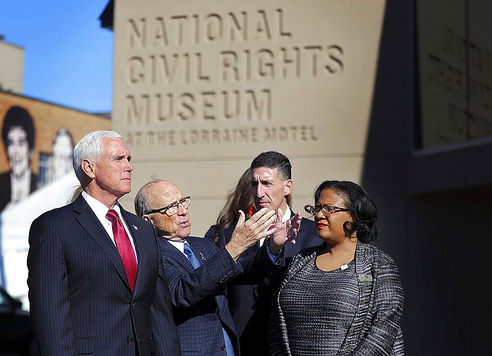 Vice President Mike Pence, left, listens to the history of the Civil Rights Museum during a visit, Sunday, Jan. 19, 2020, to Memphis, Tenn., on the eve of Dr. Martin Luther King Jr. Day. (Patrick Lantrip/Daily Memphian via AP)
