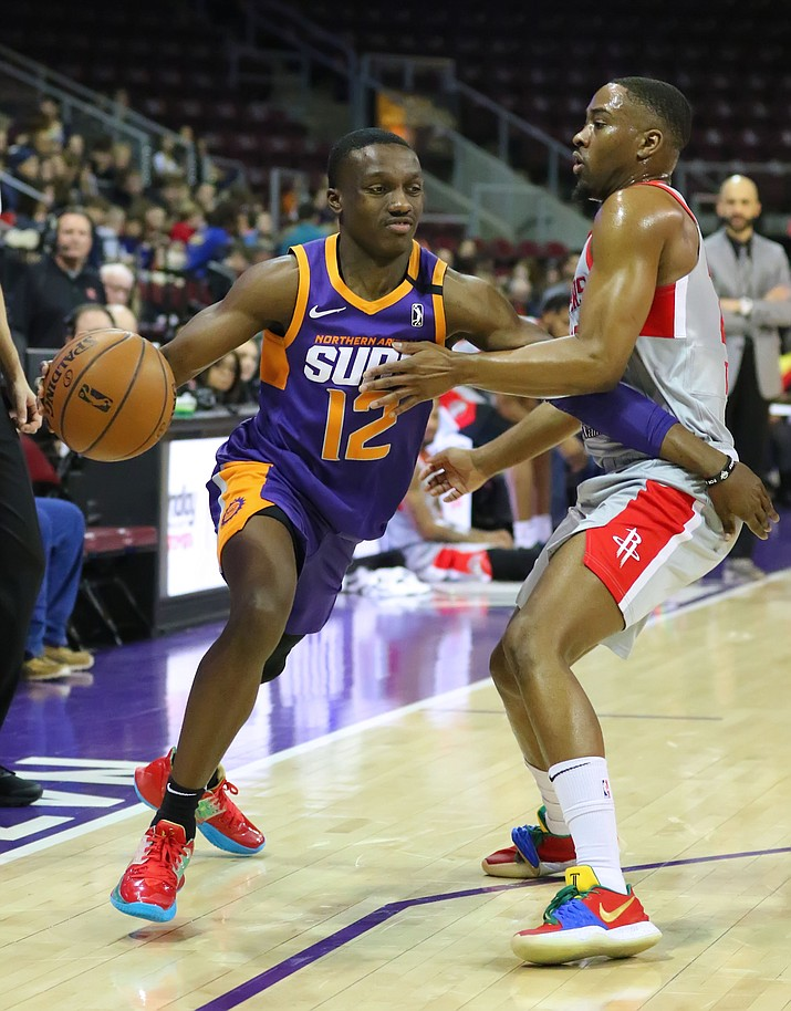 Northern Arizona Suns guard Jared Haper (12) dribbles past a defender during a game against the Rio Grande Valley Vipers on Tuesday, Jan. 21, 2020, at the Findlay Toytota Center in Prescott Valley. (Matt Hinshaw/NAZ Suns)