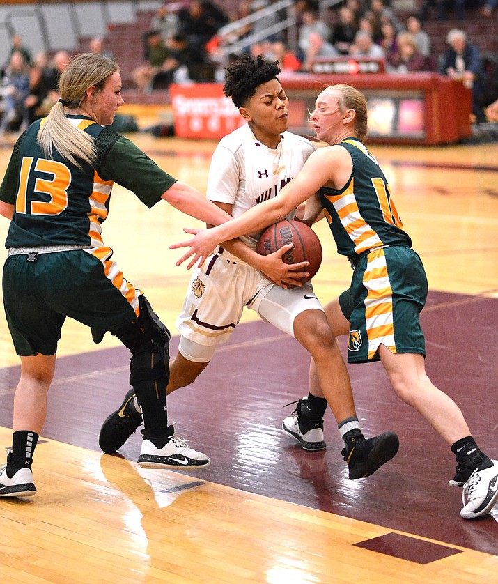 The Winslow Lady Bulldogs defeated the Show Low Cougars, 82-55, Jan. 14 in Winslow. The Lady Warriors also beat theri rivals, 45-20. (Todd Roth/NHO)
