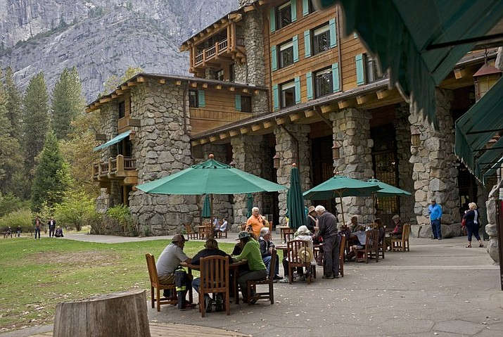 People dine outside the Ahwahnee Hotel in Yosemite National Park, Calif. Yosemite National Park is investigating about 170 reports of gastrointestinal illnesses and has confirmed two cases of norovirus, officials said Jan. 16. (AP Photo/Ben Margot, File)