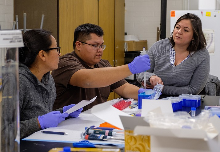 Diné College students Angelene Yazzie, Wyatt Tohee and University of Arizona professor Dr. Maira Soto are participants in the $1.3 million collaboration between Diné College and the University of Arizona. The project aims to train Native American students in neuroscience research careers. (Photo/Diné College)