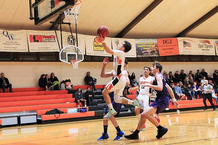 Viking Zain Grantham takes a fast break to the basket during the Jan. 11 game with BASIS-Flagstaff. (Wendy Howell/WGCN)