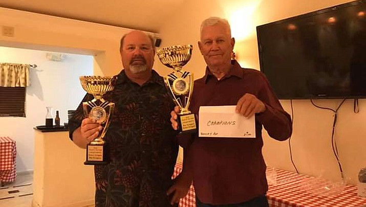 Donnie Scroggins, left, and his father Ray, hold the award they received for being the top team of the Kingman Bass Club in 2019. (Courtesy photo)