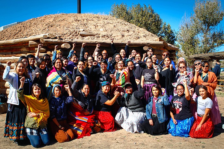 "Participants in an indigenous doula training, coordinated by Changing Woman Initiative, pose for a photo outside a hogan in Window Rock on Thursday, Oct. 24, 2019. Such training used to draw a dozen women – this one drew 40. ""The demand just kind of exploded,"" midwife and facilitator Melissa Brown said. More than 100 people applied for the workshop. (Photo by Delia Johnson/Cronkite News)"