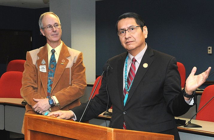 Navajo Nation President Jonathan Nez explains Jan. 15 why his tribe wants to keep some taxes generated by sales on tribal lands. He supports legislation to keep the taxes on the reservation which was crafted by Rep. Bob Thorpe (left). (Howard Fischer/Capitol Media Services)